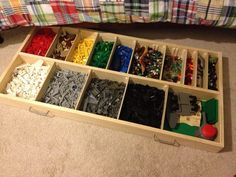 "Under-bed Lego storage. 2'x4'x3.5"", with adjustable bins. Over 2 cubic feet of storage volume. Cost to build: Fifty bucks. Time to build: ~6 hours."