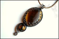 Tiger eye and bronze wire wrapped pendant double sided by amorfia, $70.00