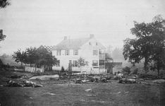 Dead horses surround the damaged Trostle House, results of the Battle of Gettysburg, in July of 1863. Union general Major General Daniel Sickles used the farmhouse as a headquarters and Union and Confederate troops fought among the farm buildings during the fierce battle.