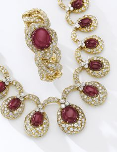 Ruby and diamond parure, Alexandre Reza, 1974 Comprising: a necklace set with a graduated line of cabochon rubies within a mount set with brilliant-cut diamonds, length approximately 465mm, a pair of ear clips set with similarly cut diamonds, suspending a swing set cabochon ruby, a bracelet, inner circumference approximately 160mm, and a ring, size 501/2, each signed A. Reza, French assay and maker's marks.