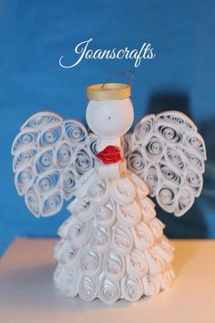 Quilled Angel Ornament with a Rose                                                                                                                                                                                 More