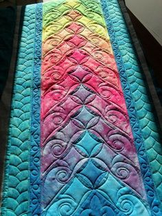 Freeform quilting uses stitchery in a variety of patterns to bind the pieces of cloth together.