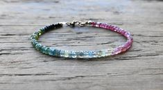 Oh my god look how pretty this is!  Watermelon tourmaline bracelet. pink and green by MarisaBecca
