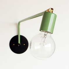 """$110 Hard-wired swing-arm lamp - This is a swinging wall lamp made by me. Lamp swivels 180 degrees on wall plate. Hand bent and welded with durable powder coat finish available in black, white, and green. Socket swivels 90 degrees on brass fitting. Steel wall plate with brass fitting and rotary switch. 16"""" and 24"""" lengths. Mounting hardware included. Made to order in about 3-4 weeks*.  110v-220v, 75watt rating"""
