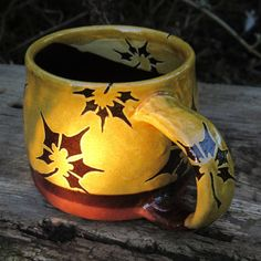 This is a hand thrown mug perfect for tea, coffee, hot chocolate etc. Our mugs are nice to look at and comfortable to hold and they make drinking your favourite beverage even more pleasurable. The inspiration for the decoration is inspired by Japanese design and from picking up fallen garden leaves! After being dipped in slip (liquid clay) the design is hand drawn using the sgraffito technique, an age old method drawing through the cream slip to reveal the red clay body. The bottom part has…