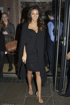 Putting her best foot forward: She accentuated her decolletage with a series of pretty nec...