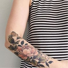 This badge of glory. | 31 Stunning Floral Tattoos To Get You Ready For Spring