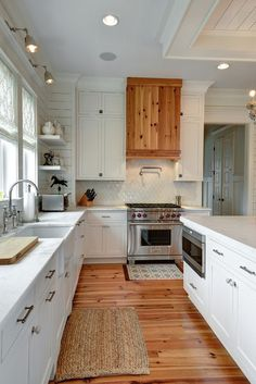 Wood Floor; transitional kitchen by William Quarles Design/Photography