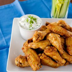 These Buffalo chicken wings are baked instead of fried. The skin still gets crispy under a coating of hot vinegary sauce.