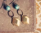 sady.  a pair of beaded brass and copper geometric earrings.