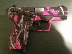 Pink camo semi-auto. I wonder who  makes this and how much does it weigh?