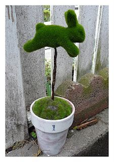 DIY Moss Bunny Topiaries ~ this needs a ribbon. Buy the bunnies at Pier 1 for less that 3 each.