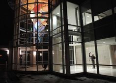 Sculptor Lyle London documents Triple Helix after it was installed into the rotunda at the Ames School of Art at Illinois Wesleyan University, last January. (The Pantagraph, David Proeber)Triple Helix 1