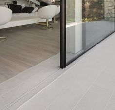 Vitrocsa Invisible Tracks - where the tracks are recessed below the flooring so only 2 slim slots are made in the flooring giving you a continuous indoor / outdoor floor.