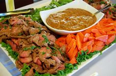 Asian Marinated Flank Steak Platter :: grilled medium rare, sliced and served with sesame pea pods, sweet chili carrots, peanut sauce, and fried wantons