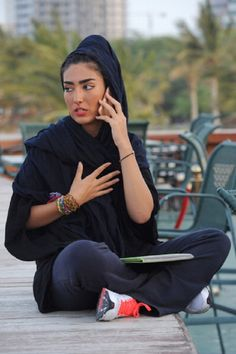 A fashionable young woman talks on her Blackberry mobile with her smart pad on her laps while sat in a coffee shop on the sea front in the late afternoon hours on April 2012 in Kish, Iran. Get premium, high resolution news photos at Getty Images Iranian Beauty, Iranian Women, Turkish Beauty, Persian People, Persian Girls, Iran Today, Iran Girls, Persian Beauties, Female Character Inspiration