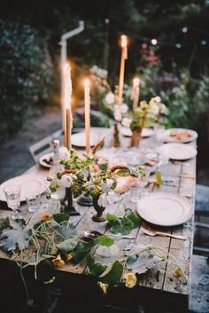 A beautiful outdoor dining table. Rustic wooden table with plant table decorations and tall candles. Outdoor Wedding Centerpieces, Wedding Table, Rustic Wedding, Reception Table, Table Centerpieces, Summer Centerpieces, Outdoor Decorations, Centerpiece Ideas, Floral Centerpieces