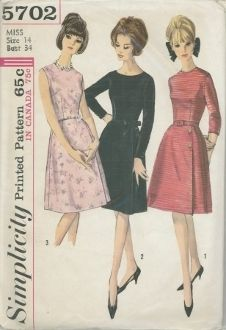 An unused original ca. 1964 Simplicity Pattern 5702.  JUNIORS' AND MISSES' ONE-PIECE DRESS: Dress features dart fitted bodice, A line skirt with deep unpressed pleat on left front. Dress has center back zipper closing; may have corded piping at waistline. V. 1 & 3 feature high round neckline. V. 2 has low scoop neckline, long, button trimmed sleeves, and ribbon bow. V. 1 has below elbow sleeves, purchased or sell fabric belt, and button trim. V. 3 is sleeveless; a purchased belt may be worn.