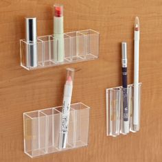 Save space in your bathroom by using these stick-on pods on the inside of your cabinet.