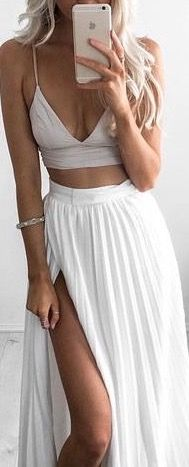 Crop top and white pleated maxi skirt with a high slit can't go wrong