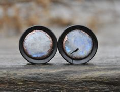 Moonstone, Ebony plugs with mayan flare and copper formed inlays by Oaks