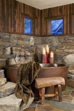 Perfection. Stone walls, copper bathtub, love it!!!