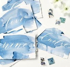 I really like the look of these watercolour table numbers...what if they were mountains?