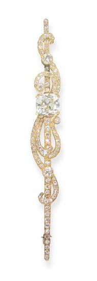 A DIAMOND BAR BROOCH, BY KOCH The diamond bar and scrolls to the central cushion-shaped diamond weighing 6.83 carats, mounted in gold, circa 1900, 11.3 cm long Signed R. Koch