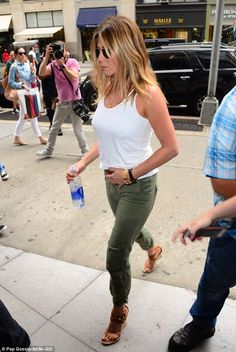 Jennifer Aniston pats her tum while showing off fuller figure in NY