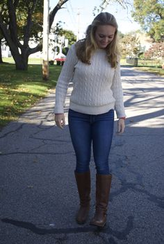 Preppy fall look: cable knit sweater, jeans + riding boots