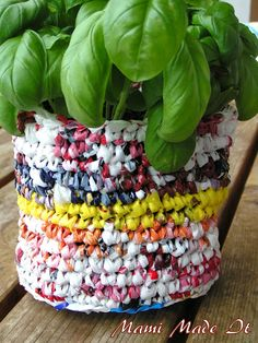 Crochet plastic bag planter.  I've been wanting to crochet with my plastic sack collection... A garden planter could be pretty cool.