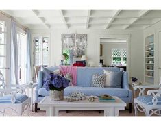 I would love a living room like this.  Blue and white - so crisp and inviting.