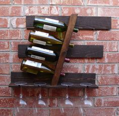 He encontrado este interesante anuncio de Etsy en https://www.etsy.com/es/listing/204532111/geometric-parallel-4-bottle-wine-rack