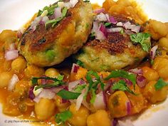 "Aloo Tikki. Fantastic!! ""mashed"" potato cake with cumin seeds. Served with garbanzo bean curry, yogurt, cilantro chutney, tamarind chutney & toasted ground cumin powder on top. Such  exotic flavors and wonderful textures. I learned it first hand from an Indian cooking instructor."