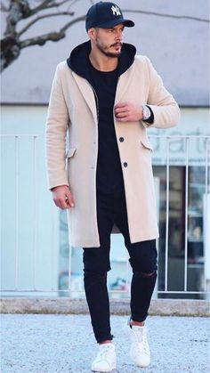 27 Really cool outfits! Stylish men's/unisex winter look — long city coat in tan with baseball cap, dark jeans and dark hoodie with classic crisp white sneakers that balance out white logo on cap Winter Outfits Men, Stylish Mens Outfits, Spring Outfits, Outfit Winter, Stylish Man, Winter Wear Men, Nice Outfits For Men, Stylish Menswear, Mens Winter Coat