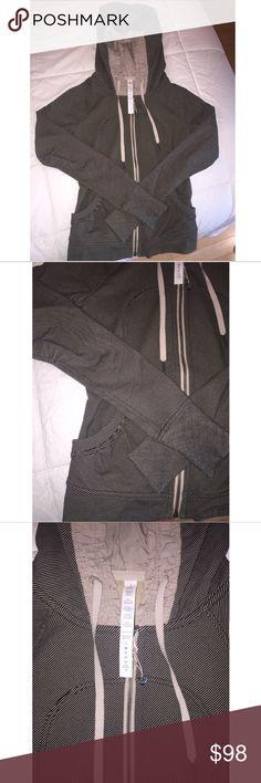 Lululemon Ruffle Scuba Hoodie LIMITED EDITION Lululemon Ruffle Scuba Zip Up Jacket with Hood. Limited Edition style! Brand new perfect condition! Size 2 lululemon athletica Jackets & Coats