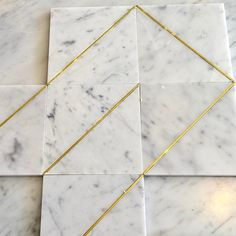 ere's another great design in our Brass Inlay Marble Tiles. Mix a few of these single inlay feature tiles with the matching plain marble