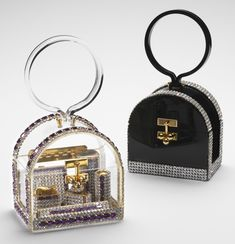 """Wiesner made rhinestone-trimmed """"birdcage"""" bags in black and clear. The clear one reveals the matching accessories within."""