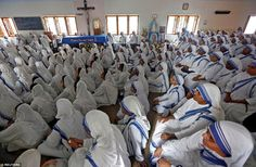 Nuns from the Missionaries of Charity in Calcutta, India, watch a live broadcast of the canonisation of Mother Teresa