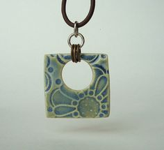 Ceramic pendant  (would like to do something like this is clay)