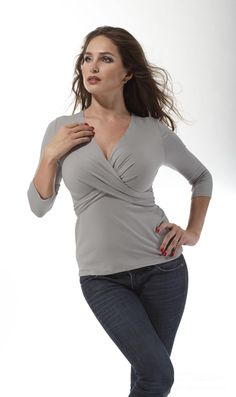 love this top...this website caters exclusively towards girls DD and up!  They sell dresses and tops that flatter a full bust and still manage to make you look classy :)