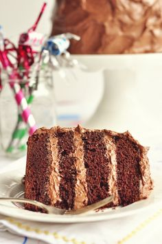 A GREAT chocolate cake is hard to come by. This one looks lovely, and with a fluffy but not-overly-sweet frosting!