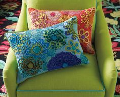 """This gorgeous bouquet of brilliant blooms is enhanced by appliqué and a sampler's worth of intricate embroidery, including a cut-embroidery technique that creates the three-dimensional feel of velvet. 14"""" x 20"""". Colors: Coral, Capri Blue #colorfulliving #accentpillow"""