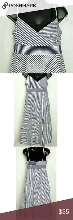 J Crew Blue & White Diagonal Stripes Summer Dress New without tags NWOT J. Crew Midi Dress. Cotton. Fully lined. Diagonal stripes. Spaghetti straps. Criss-cross V neckline. Empire waist. Zippered back. Size medium. Approximate measurements of the dress are Bust 34 inches and Length 42 inches. Excellent condition. This J. Crew dress is gorgeous! J. Crew Dresses