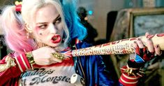 Margot Robbie offers some insight about playing a character as 'crazy' as Harley Quinn and working with Will Smith again on Suicide Squad.