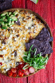 Taco ingredients (including a protein packed meat and quinoa filling) are stuffed into this casserole and then topped of with tons of cheese, fresh veggies, avocado and lots of tortilla chips. Who needs the tortillas when you've got this beauty for dinner?