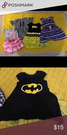 Lot of 3T dresses - 4 total included. Four EUC dresses as described below: Peppa Pig dress with ruffles, Peppa Pig brand, size 3T. Navy blue gingham dress, Old Navy, size 3T. Batman dress  with yellow tulle, size 3T. Included cape as seen in the second pic. Minor cracking on the batman logo on the dress. Blue and pink tunic dress with drawstring waist. Cherokee, size 3T. Looks adorable with pink leggings for spring and fall! Dresses Casual