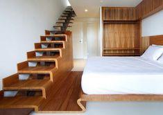 escalier en bois droit de design épuré à limon central dans la chambre à coucher en bois
