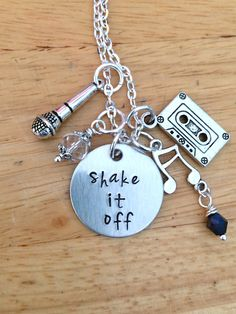 Inspired by the hit song Shake it off, this charm necklace is awesome sauce!!  This piece features a 1 inch hand stamped aluminum quote pendant,
