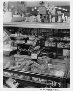 """ladies hair tools available at The J.L. Hudson Company Department Store. Displayed atop a retail counter is a gift idea of Ladies Jewelite hair combs and brushes. Affixed signage reads, """"Thoughtful Gift! Jewelite Bonnie Kit, $1.45 plus 4¢ tax."""" Ladies toiletries and perfumes are visible throughout the retail display."""